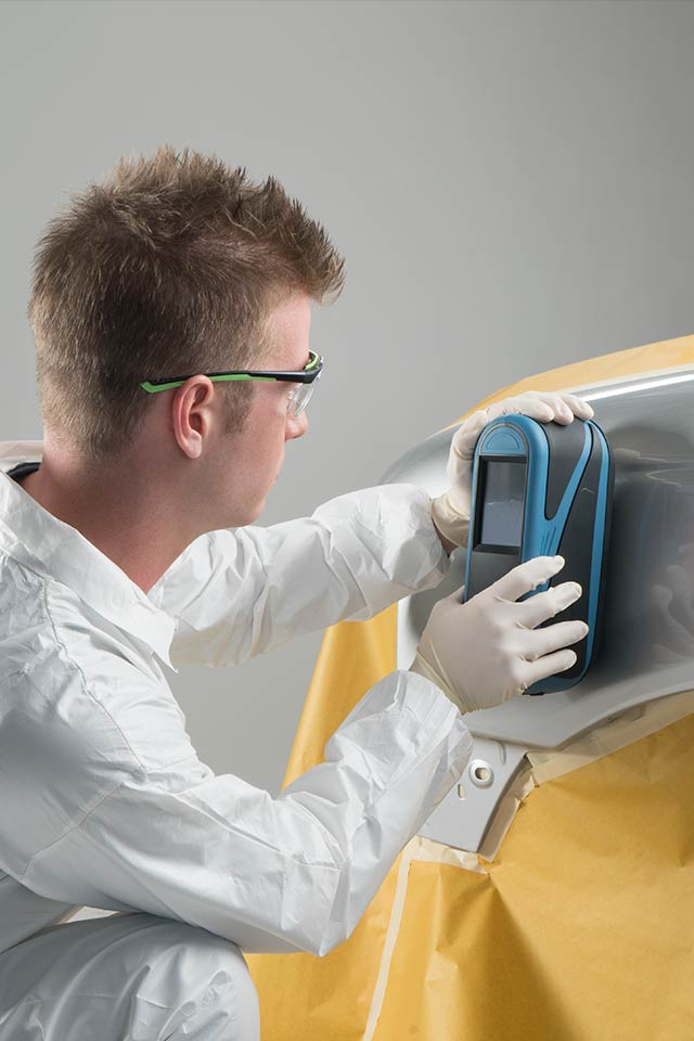 Picture of a painter taking a reading with the RAPIDMATCH device